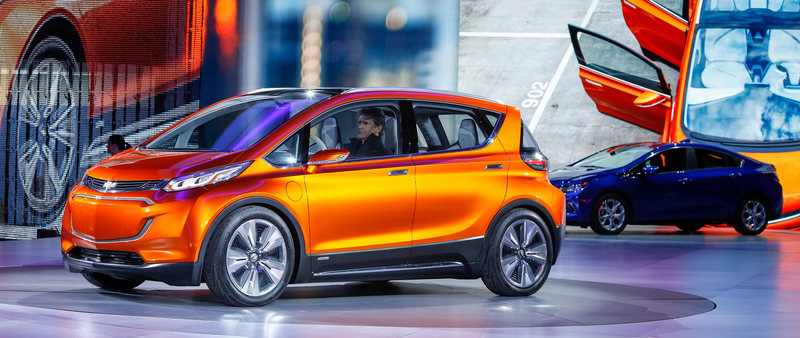 The Chevrolet Bolt EV concept vehicle (left) makes its global debut Monday, January 12, 2015 at the North American International Auto Show in Detroit, Michigan. The Bolt EV concept is Chevrolet's vision for an affordable, long-range, all-electric vehicle designed to offer more than 200 miles of range - starting around $30,000. The 2016 Chevrolet Volt electric vehicle with extended range was also unveiled. (Photo by Jeffrey Sauger for Chevrolet)