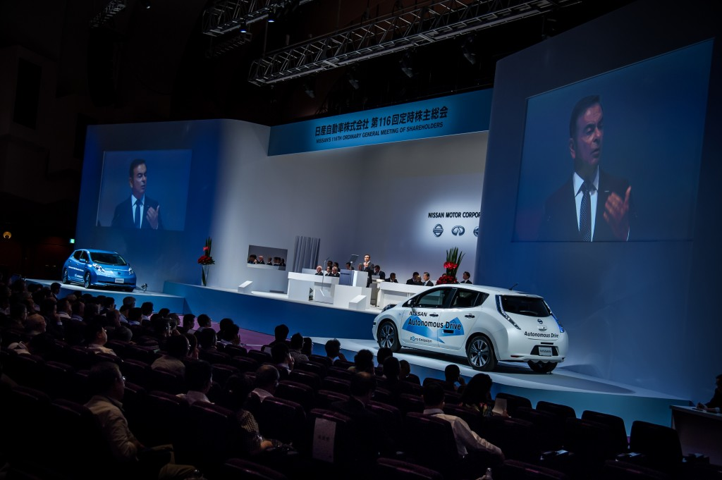 116th Nissan General Shareholders Meeting - showing a Leaf with self-driving features, the other with really long range