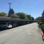 Solar carports at apartment complexes to allow EV charging at multi-unit-dwellings
