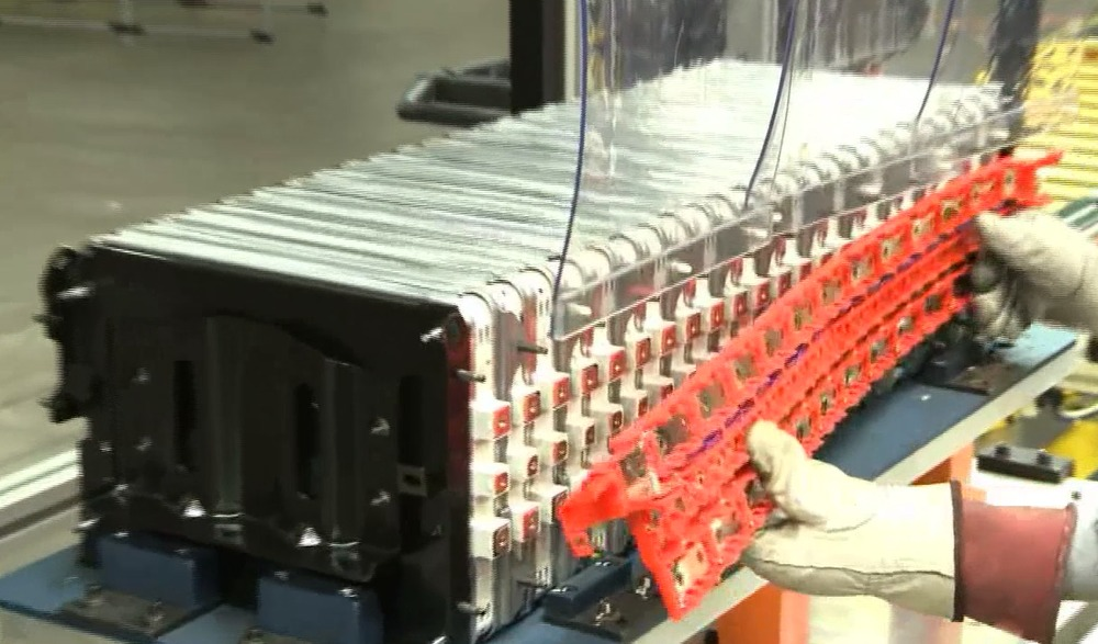 Busbar being readied to attach to the group of modules.