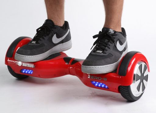 """""""Red self-balancing two-wheeled board with a person standing on it"""" by Soar Boards (www.soarboards.com) - https://www.flickr.com/photos/136833700@N04/21403154443/. Licensed under CC BY 2.0 via Commons - https://commons.wikimedia.org/wiki/File:Red_self-balancing_two-wheeled_board_with_a_person_standing_on_it.png#/media/File:Red_self-balancing_two-wheeled_board_with_a_person_standing_on_it.png"""