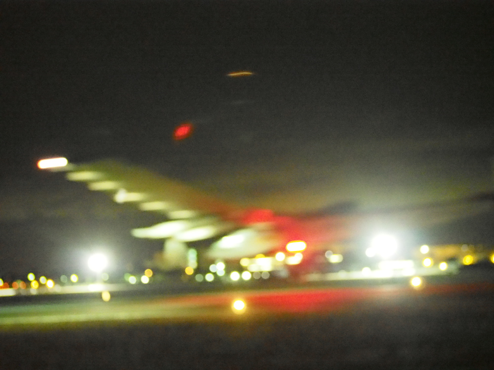 This is the best I could do for the Solar Impulse landing at Moffett Field. These pictures were shot at midnight, in the dark, with the camera adjusted to 26,000 ISO ...