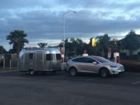 This Tesla Model X is towing a trailer, an important feat on its own merit, but was blocking at least three Supercharger stalls, bad etiquette.